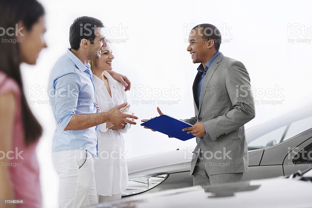 Closing the deal on a new car royalty-free stock photo