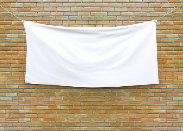 Cloth banner hanging on brick wall picture id851862992?b=1&k=6&m=851862992&s=612x612&w=0&h=7xirvbeskk8kene azf7vzk4ypesrb7pltjkwcsw0no=