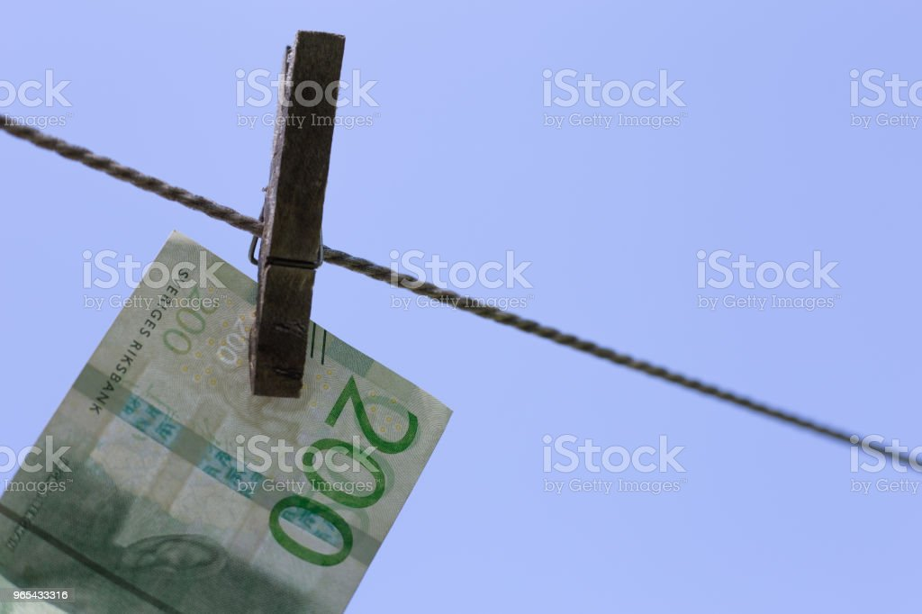 Cloth clamp with banknotes royalty-free stock photo