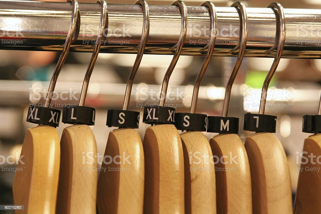 cloth hanger with sizer stock photo