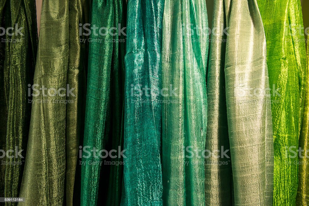 cloth in a row with shades of green stock photo