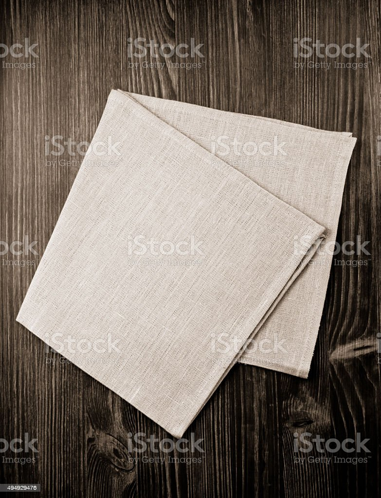 cloth napkin on wood stock photo