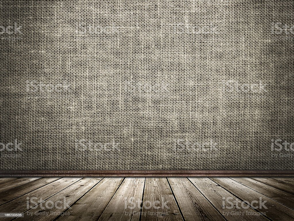 Cloth wall and wooden floor in a grunge style stock photo