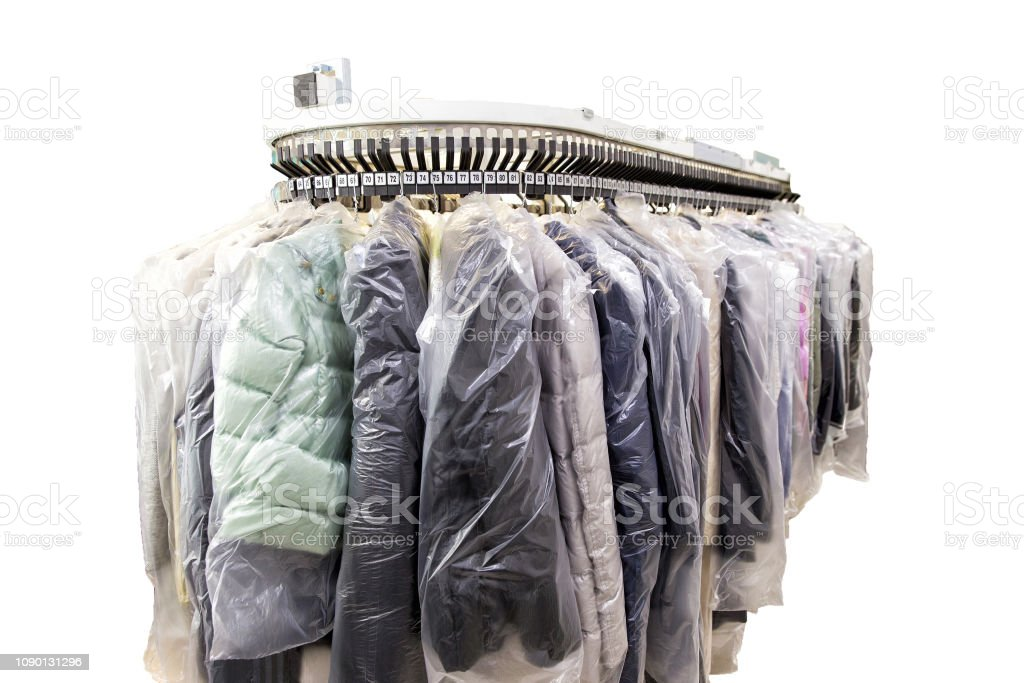 Clothes after dry cleaning in the laundry stock photo