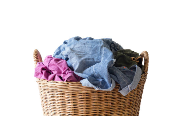 Clothes are put in a basket. Dirty clothes are put in a basket on white background isolated laundry basket stock pictures, royalty-free photos & images