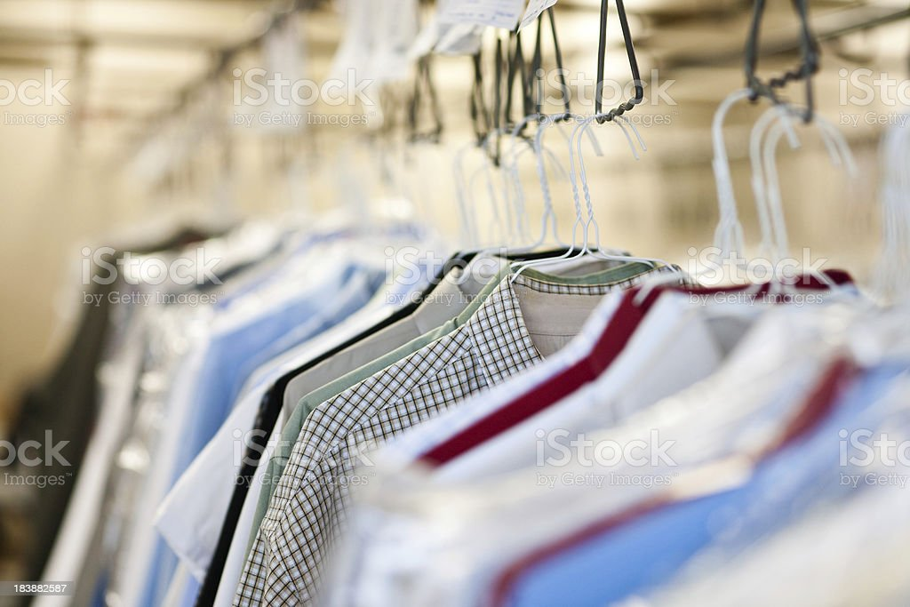 Clothes at a dry cleaners stock photo