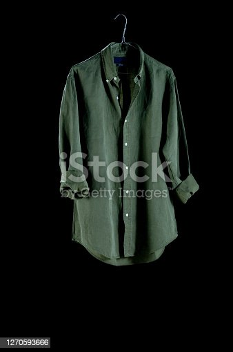 Clothes: Blouse green on hanger, isolated on a white background