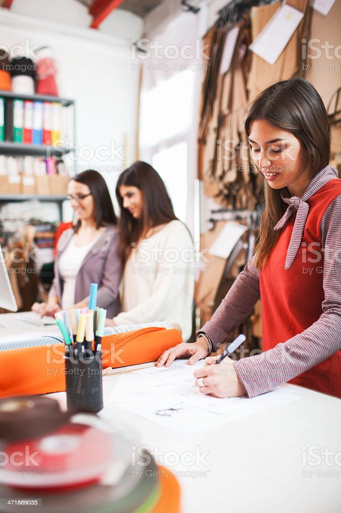 Clothes designer in her small business studio. royalty-free stock photo