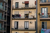 clothes drying in a apartment facade.