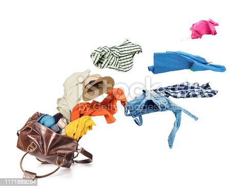 istock Clothes flying from brown skin luggage bag isolated on a white background 1171889254