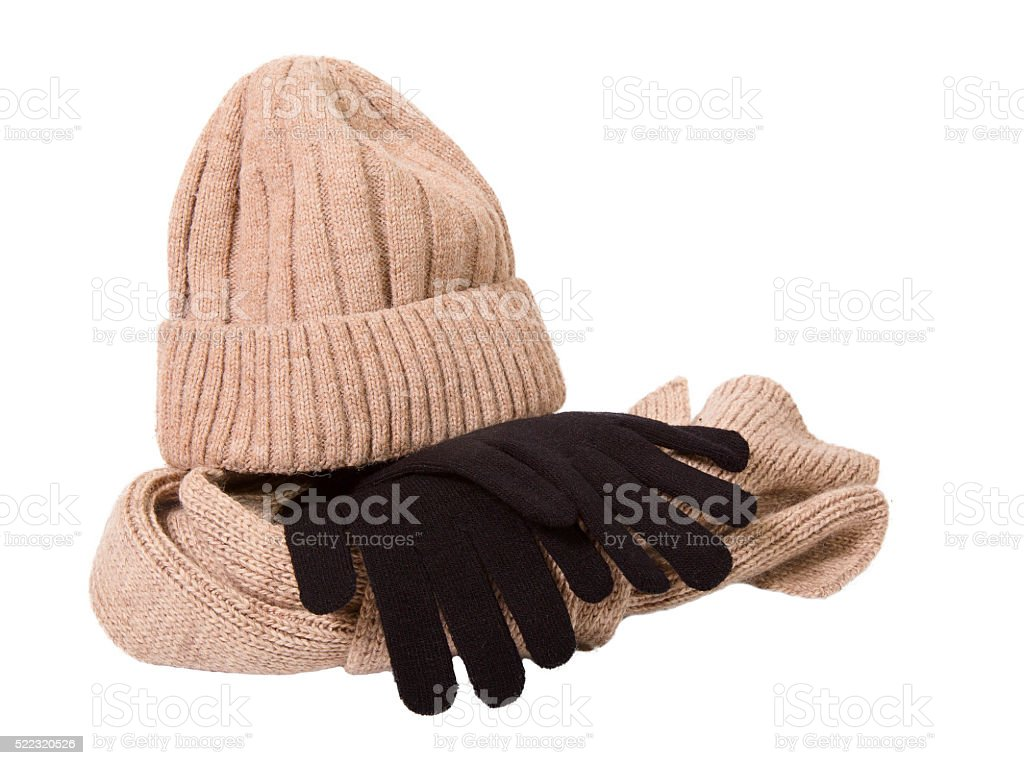 Clothes for a cold season: woolen cap, scarf and gloves stock photo