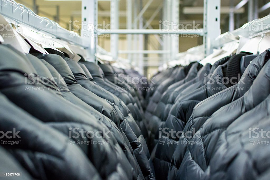Clothes hang on a shelf in a designer clothes store stock photo