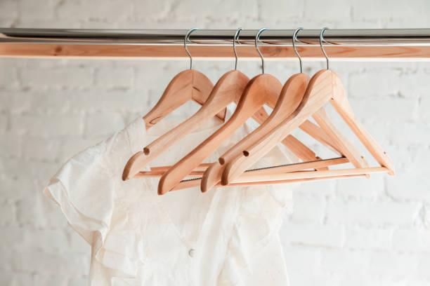 Clothes hang on clothing rack stock photo