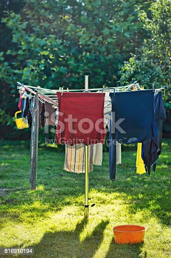 istock Clothes hang on the rope on sunny day 816910194