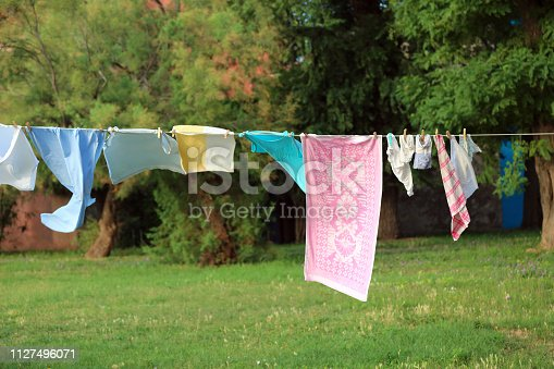 many clothes hanging and dressed to dry outdoors on the clothesline