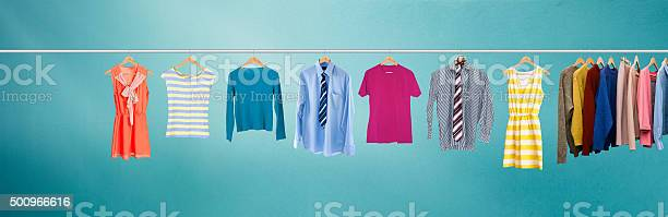 Clothes hanging on rail picture id500966616?b=1&k=6&m=500966616&s=612x612&h=3tlgv6rpayage1af bf7mccliplxs8 sjuoifayrmg0=