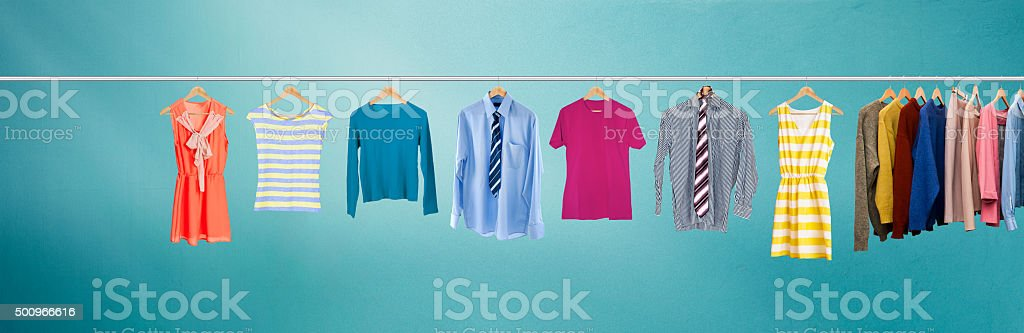Clothes hanging on rail stock photo