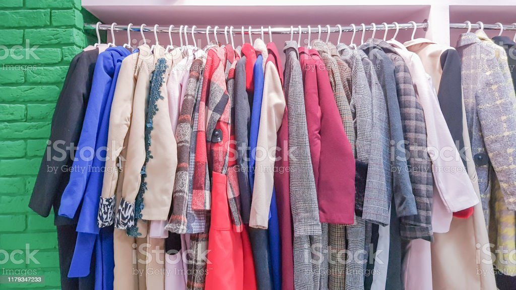 clothes hanging on shelves in a designer clothing store clothes shop clothing aisle in a supermarket stock photo download image now istock