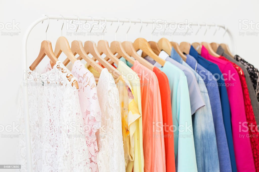 Clothes hanging on the rack stock photo