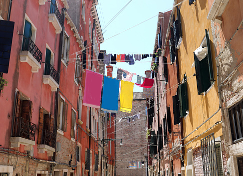 clothes hanging out to dry in a narrow Venice alley on a summer day