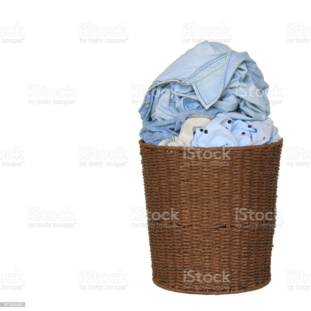 Clothes in a laundry wooden basket on white background royalty-free stock photo