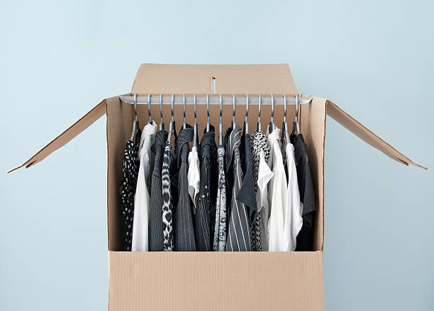 Clothes in a wardrobe box for easy moving stock photo
