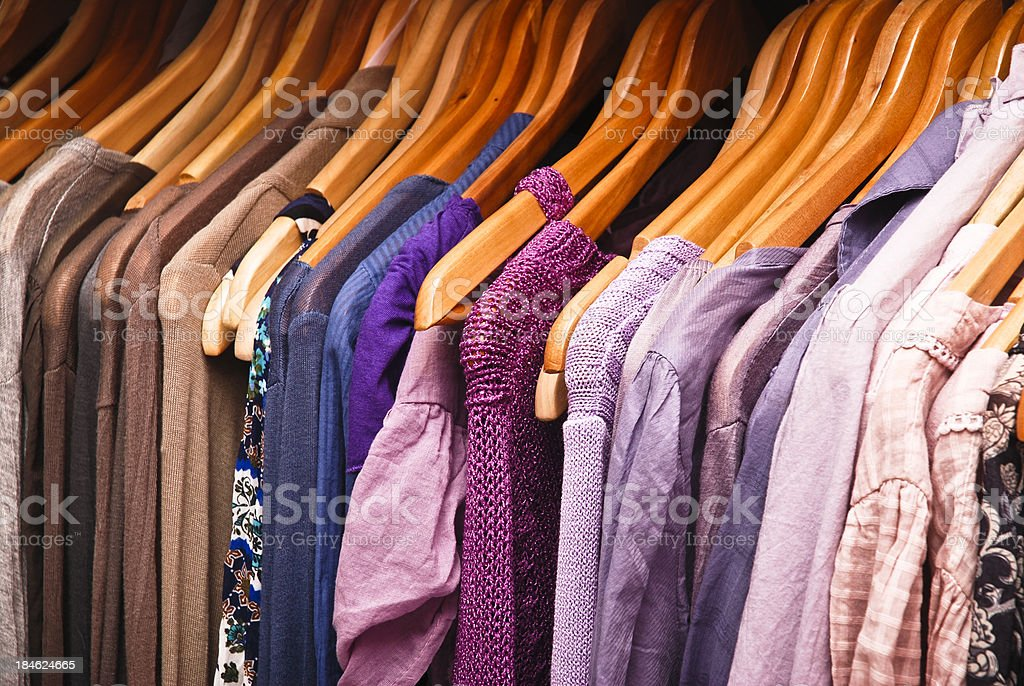 Clothes in hangers stock photo