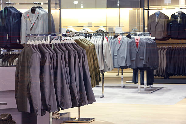 clothes in storefront window. - menswear stock photos and pictures