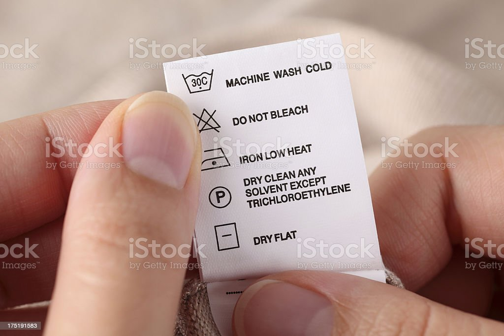 Clothes label with cleaning instructions stock photo