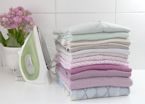 clothes laundry - ironing stock photos and pictures