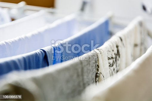 istock Clothes left hanging to dry on a clotheshorse 1064995376