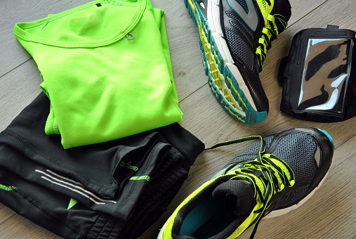 Clothes make running with isotonic drink, phone and T-shirt
