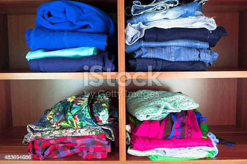 1146468307 istock photo Clothes neatly folded on shelves 483694686