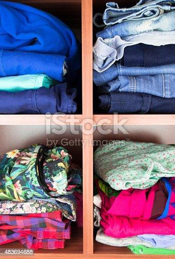 1146468307 istock photo Clothes neatly folded on shelves 483694688