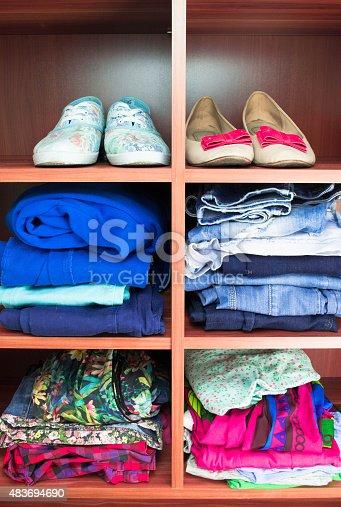 1146468307 istock photo Clothes neatly folded on shelves 483694690