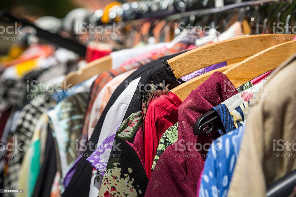 clothes on a rack on a flea market stock photo