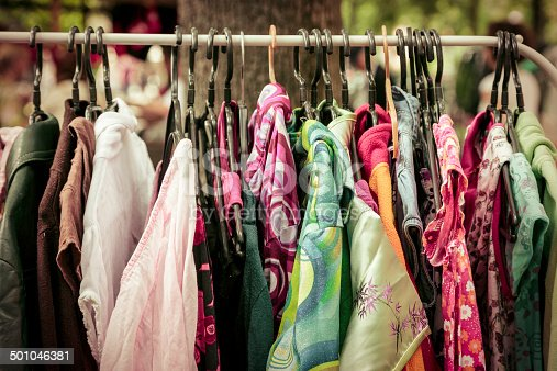 clothes on a rack on a flea market.