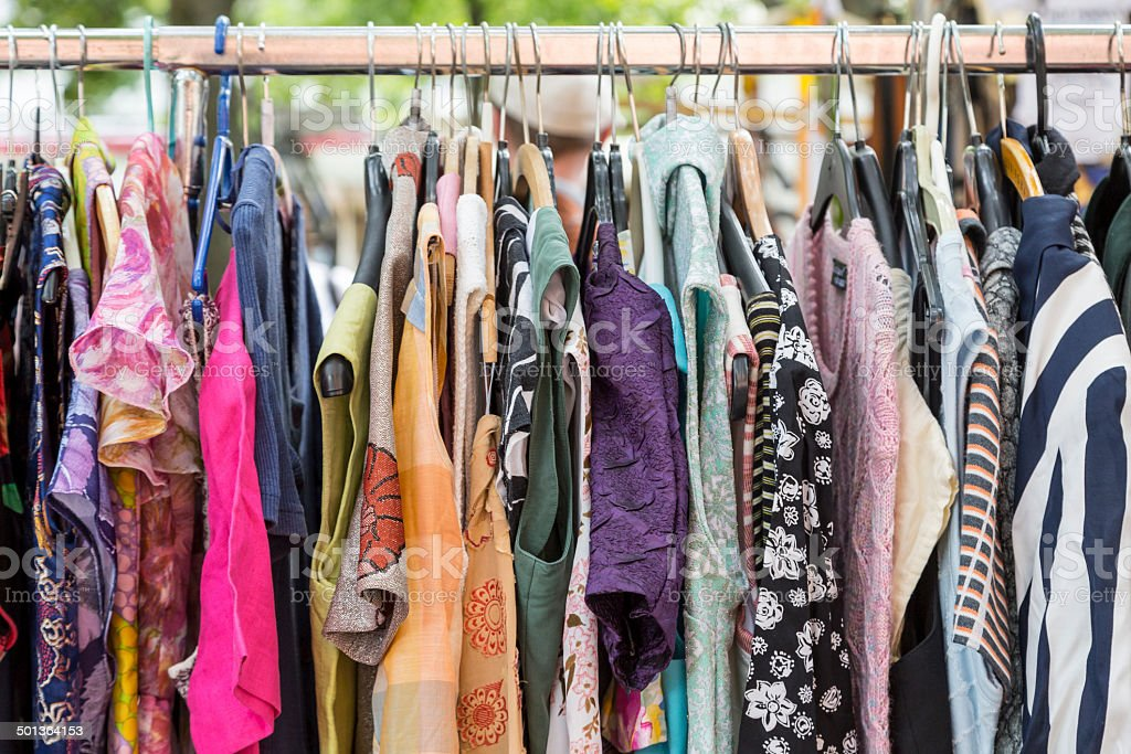 clothes on a rack on a flea market​​​ foto