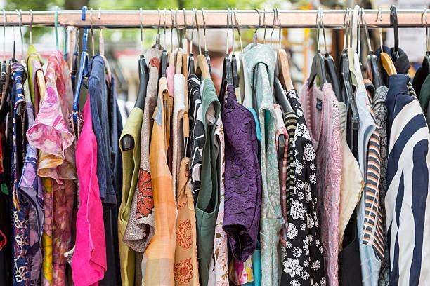 clothes on a rack on a flea market stock photo