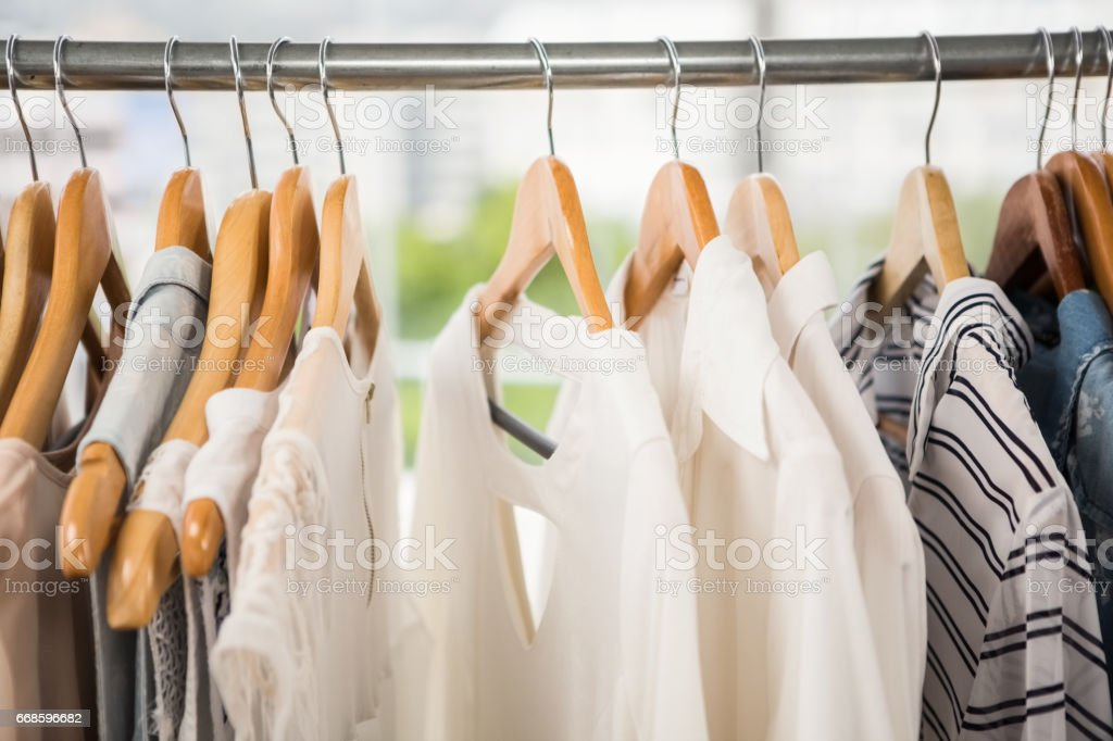 Clothes on clothes rail stock photo