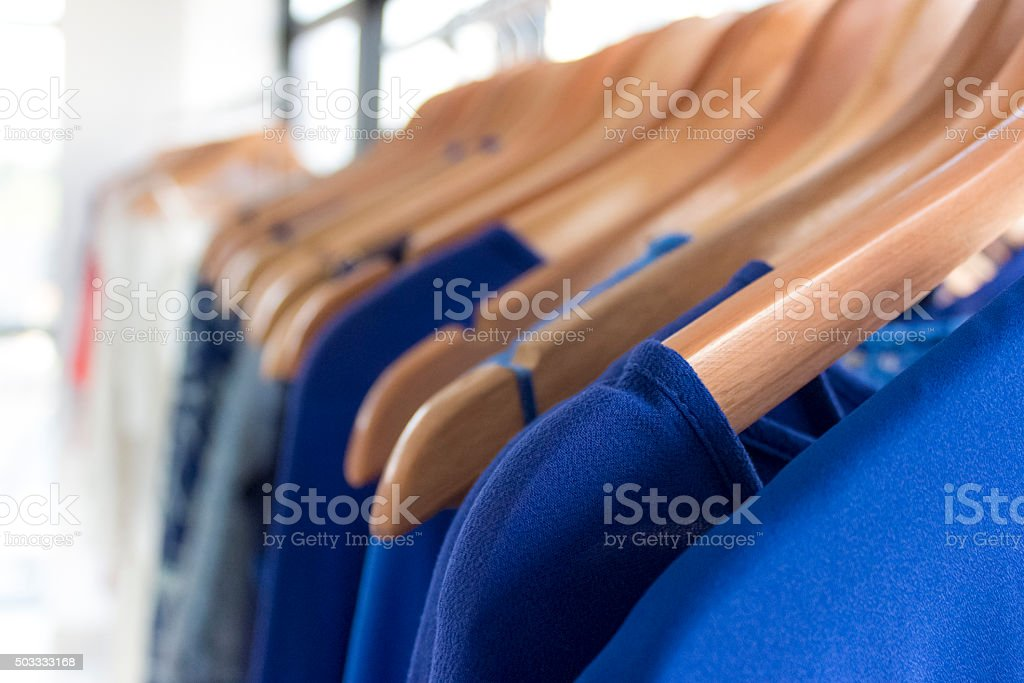 Clothes on wooden hangers stock photo