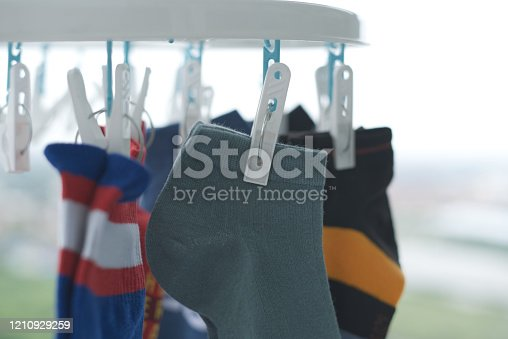 1146468292 istock photo Clothes peg clamping socks being dried 1210929259