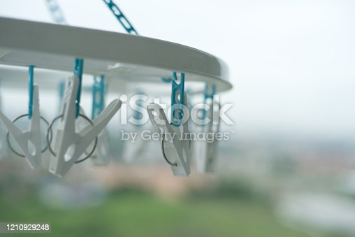 1146468292 istock photo Clothes peg hanging on clothes rail  With a balcony view 1210929248