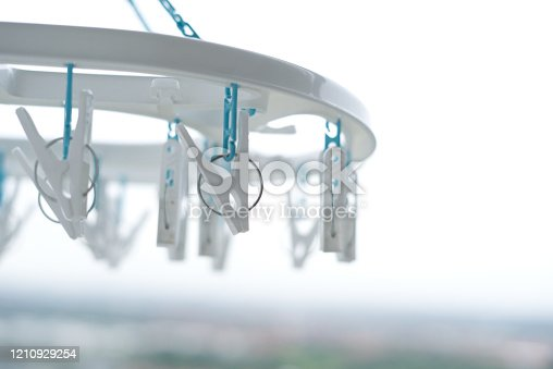 1146468292 istock photo Clothes peg hanging on clothes rail  With a balcony view 1210929254