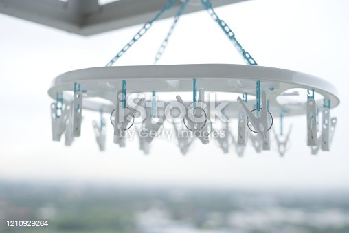 1146468292 istock photo Clothes peg hanging on clothes rail  With a balcony view 1210929264