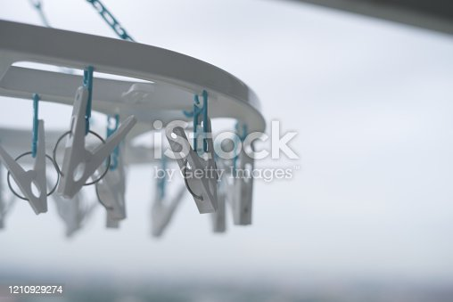 1146468292 istock photo Clothes peg hanging on clothes rail  With a balcony view 1210929274