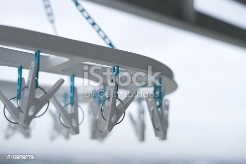 1146468292 istock photo Clothes peg hanging on clothes rail  With a balcony view 1210929279