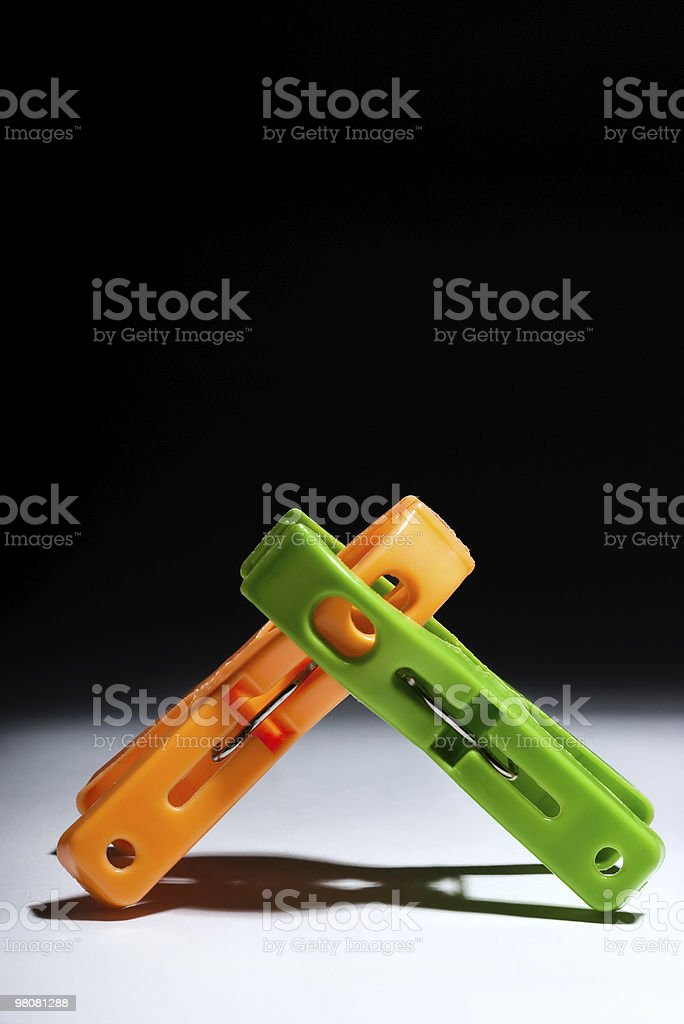 clothes pegs fighting royalty-free stock photo