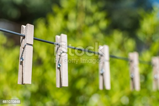 Clothes Pegs on was washing line in the sun