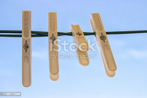 Clothes Pegs on White Background